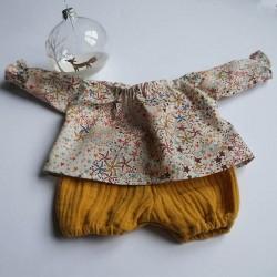 tenue pour poupée